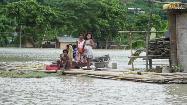 july 2020. a family sheltering on a bamboo pontoon in the flooded area, due to monsoon rains, in a flood affected village kamrup district of assam,... - india stock videos & royalty-free footage