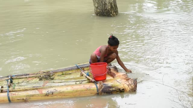 july 2020. a girl washing clothes on a banana tree raft in the flooded area, due to monsoon rains, in a flood affected village morigaon district of... - rural scene stock videos & royalty-free footage