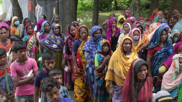 july 2020: families waiting for rice handouts, distributed by the vulnerable group feeding programme on july 26 2020 in dhamrai, bangladesh. this is... - scratched stock videos & royalty-free footage