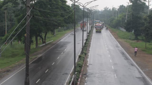 july 2020: traffic on a busy dhaka-aricha highway in heavy rain at savar near dhaka. - backgrounds stock videos & royalty-free footage