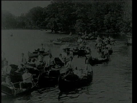 july 21, 1904 ws people paddling 50 canoes in the charles river / boston, massachusetts, united states - 1904 stock videos & royalty-free footage