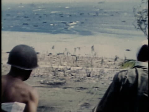 july 24 1944 ha men walking down steep hill / guam - guam stock videos & royalty-free footage