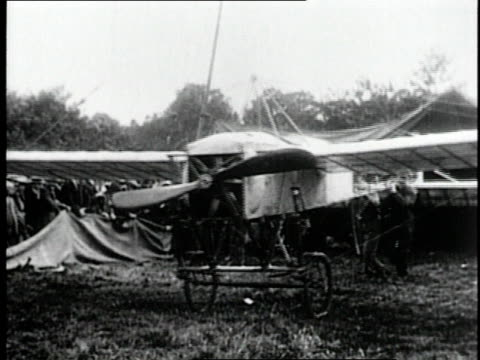 July 25 1909 MONTAGE Louis Bleriot taking off over English Channel for flight from France to United Kingdom / France