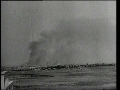 july 25, 1943 montage columns of smoke rising from bombings / rome, italy - anno 1943 video stock e b–roll