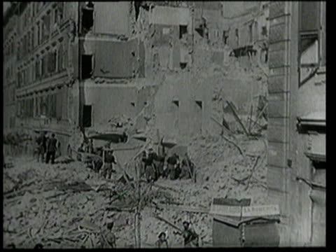 July 25 1943 MONTAGE People picking through rubble and debris next to demolished apartment buildings / Rome Italy