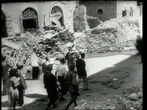 july 25 1943 montage princess marie jose of piedmont walking with crowd of people through rubble from bombing / rome italy - piedmont italy stock videos & royalty-free footage