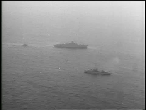 b/w july 26 1956 aerial long shot two ships boat on ocean / newsreel - atlantic ocean stock videos & royalty-free footage