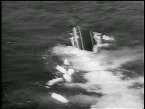 july 26, 1956 aerial ship, andrea doria, sinking in ocean after crash / newsreel - 1956 stock-videos und b-roll-filmmaterial