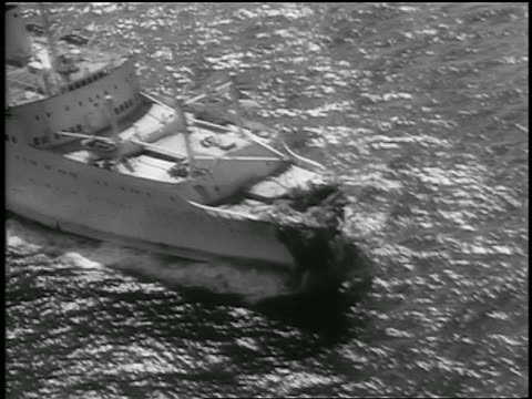 july 26, 1956 aerial ship, stockholm, with smashed front end on ocean / crashed with andrea doria - 1956 stock-videos und b-roll-filmmaterial