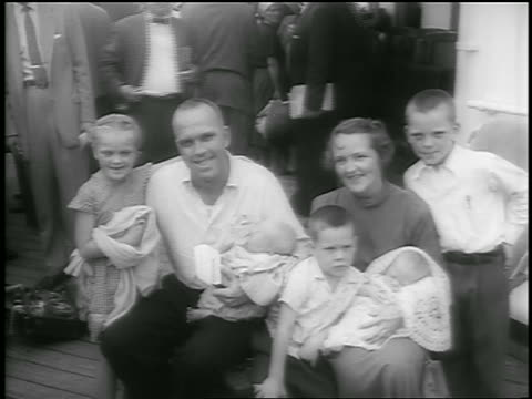 july 26, 1956 couple with 3 children + 2 babies wave / survivors of andrea doria on ile de france - two parents stock videos & royalty-free footage
