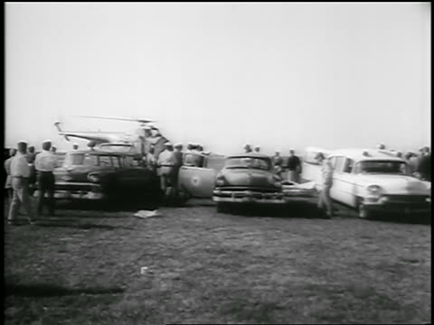 b/w july 26 1956 helicopter lands in field near people ambulances after andrea doria crash - 1956 stock videos and b-roll footage