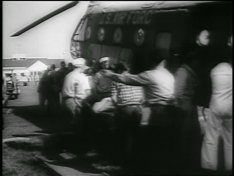 b/w july 26 1956 men take injured person from helicopter on stretcher after andrea doria crash - us airforce stock videos & royalty-free footage