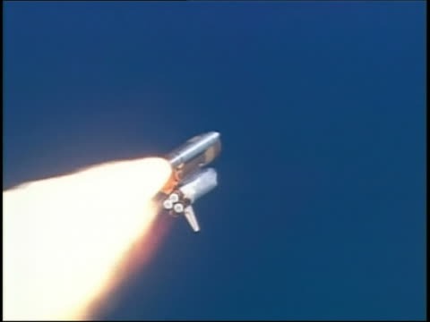 july 26, 2005 low angle tracking shot space shuttle discovery climbing into atmosphere / edwards afb, ca - space shuttle discovery stock videos & royalty-free footage