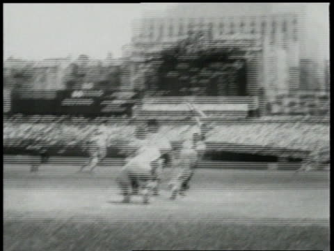 vídeos de stock e filmes b-roll de july 29, 1957 baseball player makes hit and runs for first base / new york city, new york, united states - 1957