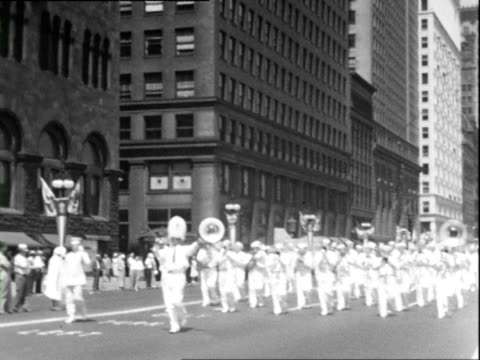 July 4, 1938 B/W MONTAGE July 4th parade of marching band with American flags / Chicago, Illinois, USA