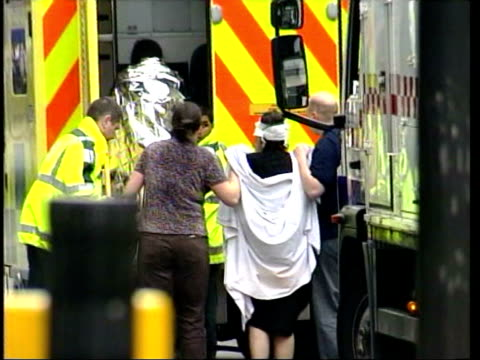 vídeos de stock, filmes e b-roll de july 7 2005 ms pan police and emergency workers helping injured people out of subway on edgeware road following terrorist bomb blasts/ ws injured... - 2005