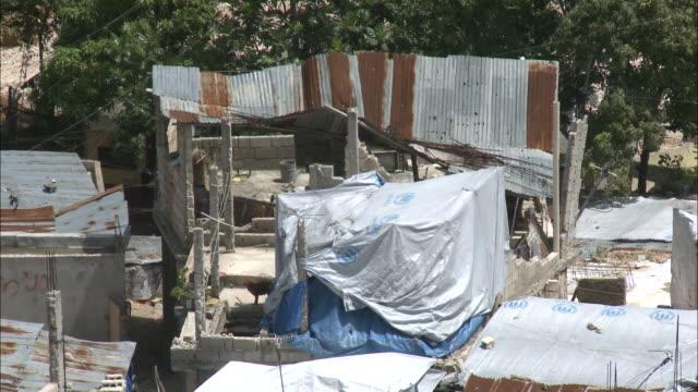 july 7 2010 pan rusty damaged rooftops in a village / haiti - hispaniola stock videos & royalty-free footage