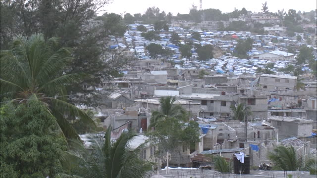 july 8 2010 pan damaged landscape of collapsed buildings / haiti - 2010 stock videos & royalty-free footage