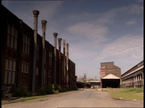 july 9 2001 pan exterior of buildings at bethlehem steel corporation / bethlehem pennsylvania united states - bethlehem pennsylvania stock videos & royalty-free footage