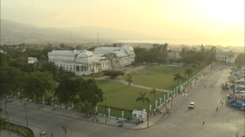 stockvideo's en b-roll-footage met july 9, 2010 montage panoramic scene atop an intersection where the badly damaged presidential palace mansion sits in ruins / haiti - 2010