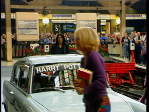 july lib king's cross station int ford anglia car as featured in harry potter books as harry potter creator j k rowling out speeded up footage of... - j.k. rowling stock videos and b-roll footage