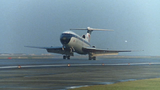 1968 montage jumbo jet airliner landing and bus driving / united kingdom - runway stock videos and b-roll footage