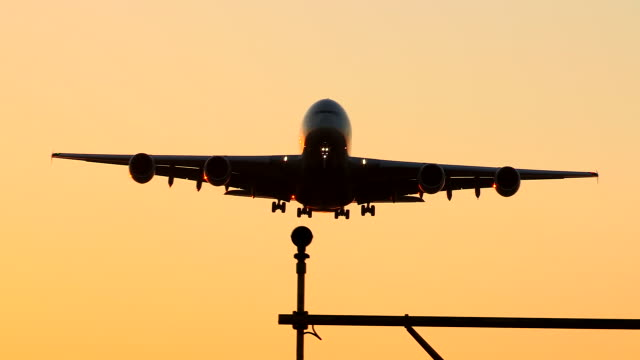 jumbo jet airliner on approach to runway - front view stock videos & royalty-free footage