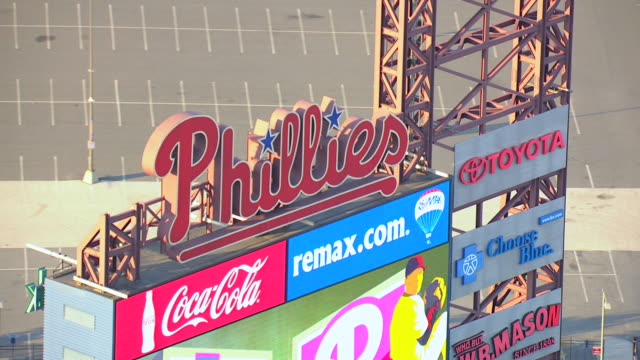 cu aerial jumbotron with advertisements and phillies sign at citizens bank park / philadelphia, pennsylvania, united states - philadelphia phillies stock-videos und b-roll-filmmaterial