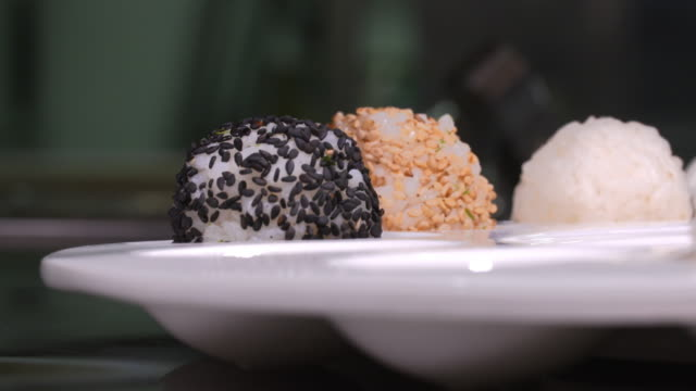 'jumeokbap' (lump of steamed rice) made with various ingredients - seaweed stock videos & royalty-free footage