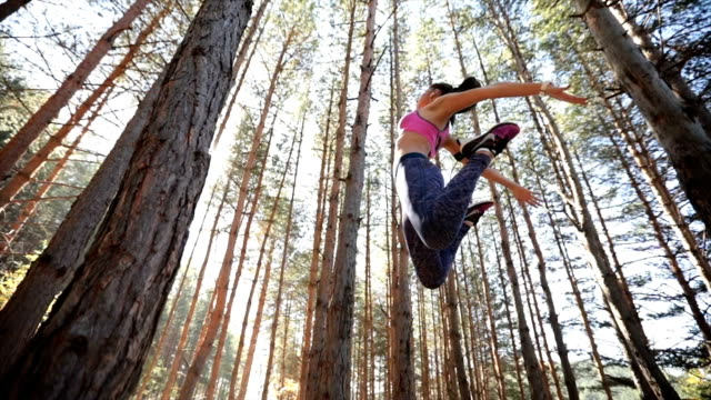 jump exercise in forest - low angle view stock videos & royalty-free footage