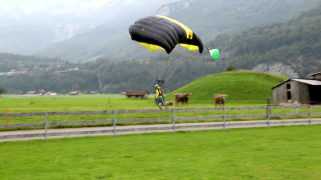 BASE jumper/wing suit flier descends from cliff