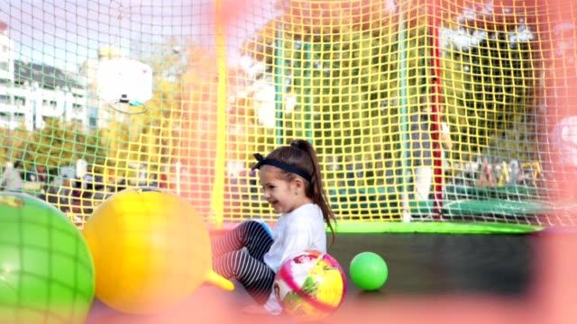 stockvideo's en b-roll-footage met springen kind plezier op een trampoline in het voorjaar - trampoline