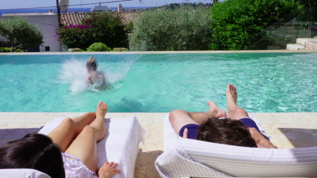 jumping into pool - family with one child stock videos & royalty-free footage