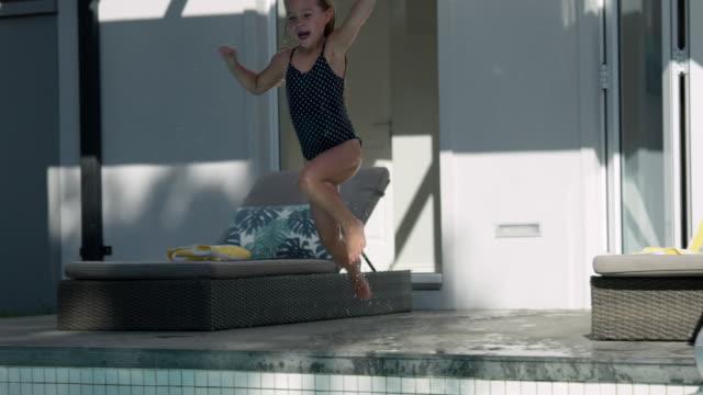 jumping into pool - 45 49 år bildbanksvideor och videomaterial från bakom kulisserna