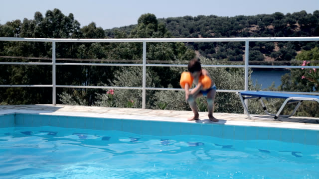 jumping into swimming pool - water sport stock videos & royalty-free footage