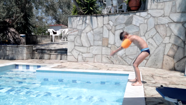 jumping into swimming pool - only boys stock videos and b-roll footage