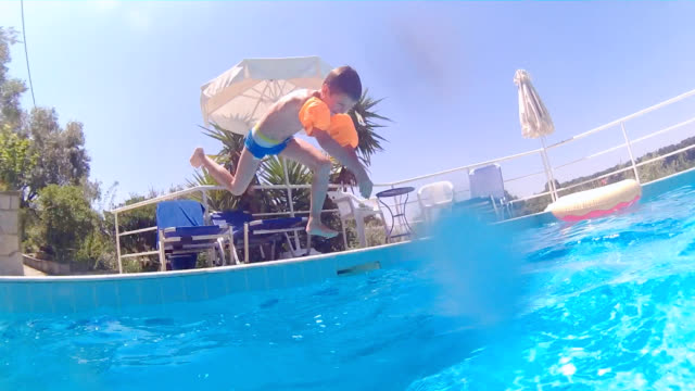 jumping into swimming pool - lido stock videos & royalty-free footage
