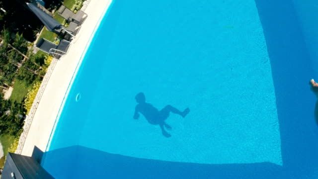 Jumping  Into The Resort Swimming Pool