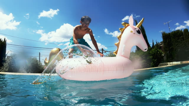 jumping on pool raft - falling stock videos & royalty-free footage