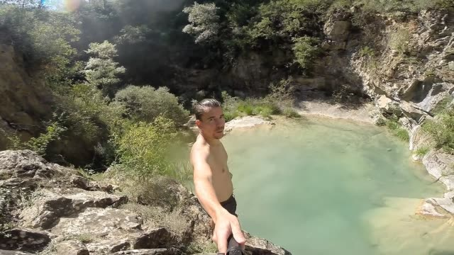 jumping on the natural pool river in summer. - only men stock videos & royalty-free footage