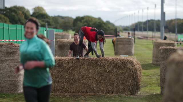 jumping over the hay - obstacle course stock videos & royalty-free footage