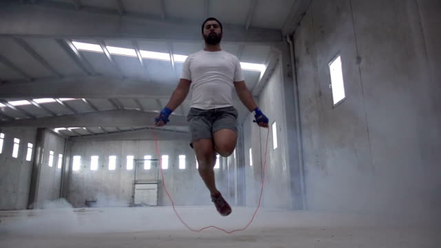 jumping rope in an old building - boxer dog stock videos and b-roll footage