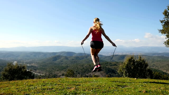 jumping rope with idyllic view - jump rope stock videos and b-roll footage