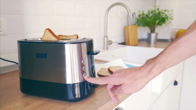 jumping toast bread. - toaster appliance stock videos & royalty-free footage