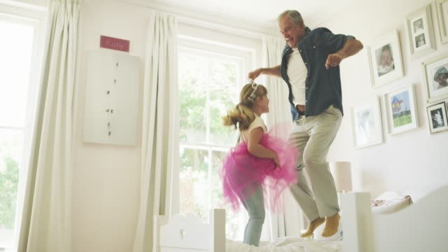 jumping up for joy with grandad! - visit stock videos & royalty-free footage