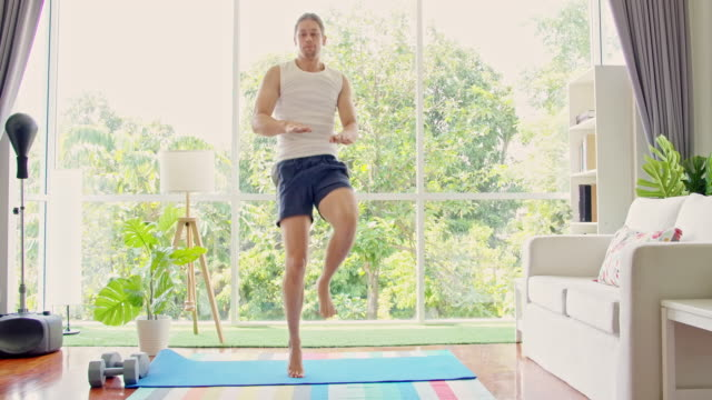 jumping with your knee touching your leg - exercise room stock videos & royalty-free footage