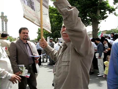 jun 2009 elderly man holding placard, shouting during political demonstration on street / teheran, iran / audio - human limb stock videos & royalty-free footage