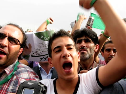 jun 2009 large group of men, dressed in green, demonstrating on street / teheran, iran / audio - human limb stock videos & royalty-free footage