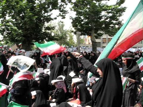 10 jun 2009 ms pan large group of people holding iranian flags demonstrating on street / teheran iran / audio - flag stock videos & royalty-free footage
