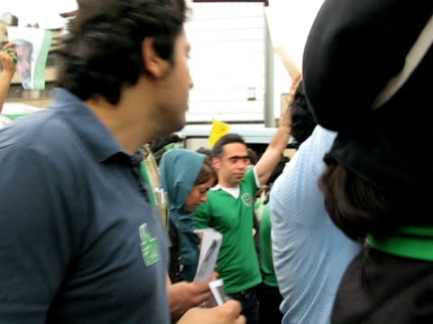 jun 2009 large group of people walking in street demonstration / teheran, iran / audio - human limb stock videos & royalty-free footage